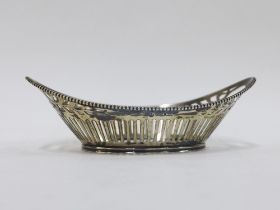 Continental silver basket of oval form with open handles and pierced sides, 18cm long
