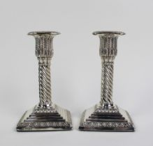 Pair of Victorian silver candlesticks, each with a detachable scone, leaf and spiral stems,
