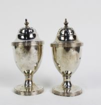 A pair of George V silver pepper pots, Chester 1911, (2)