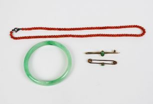 Two 9ct gold bar brooches, jade bangle and a vintage strand of coral beads (4)