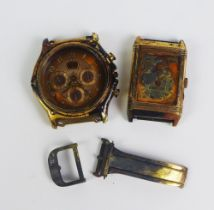 Scrap 18ct gold watch parts, fire damaged parts from a Gent's Ebel gold cased watch and a Gents's