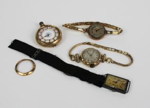 Two early 20th century 9ct gold cased lady's wristwatches and a 9ct gold cased fob watch and