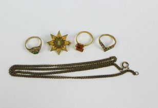 18ct gold topaz ring, two 9ct gold gemset rings, a chain necklace stamped 375 and a yellow metal