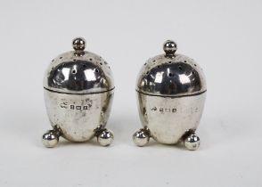 A pair of George V silver pepper pots, Elkington & Co, Birmingham 1914, (2)