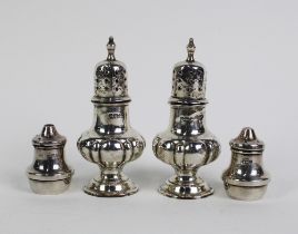 A pair of late Victorian silver pepper pots, in the form of miniature castors, Walker & Hall,