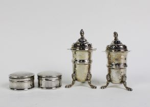 A pair of George V silver pepper pots, Birmingham 1911 and a pair silver pill boxes, Birmingham