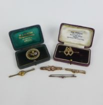Three 9ct gold bar brooches, a white metal bar brooch set with diamonds and ruby and two seed