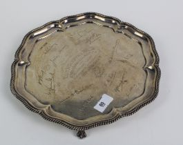George V silver presentation tray with a gadrooned pie crust rim, inscription to centre within a