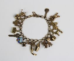 9ct gold charm bracelet hung with a collection of mainly 9ct gold charms, overall weight approx 28g