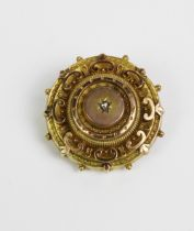 Victorian yellow metal brooch, set with a single old cut diamond and with a glazed locket panel to