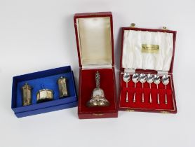 Silver bell with filigree handle, London 1987, boxed together with a three piece silver condiments