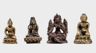 FOUR SMALL CULT BRONZES