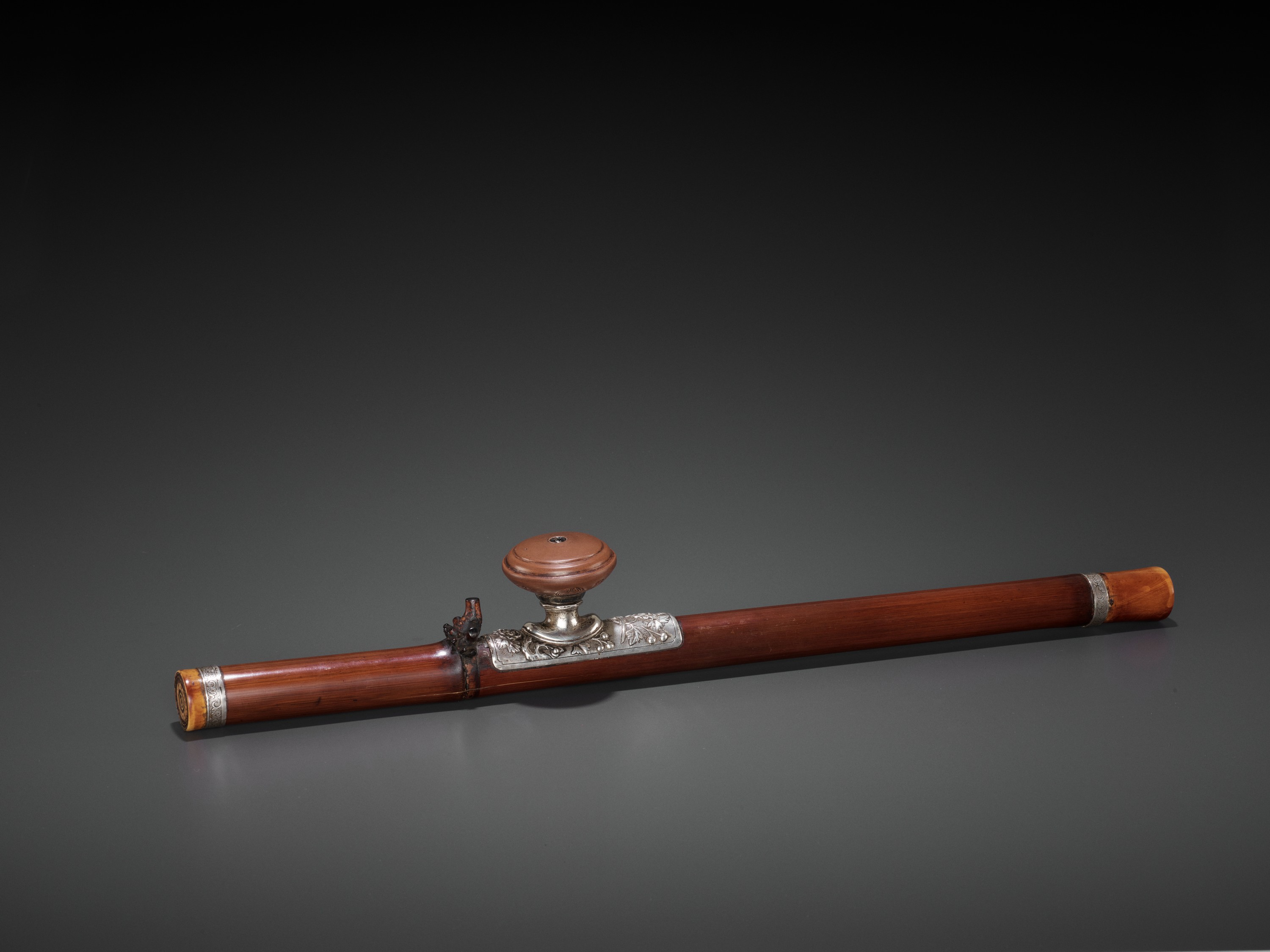 A BAMBOO OPIUM PIPE WITH IVORY, SILVER AND YIXING CERAMIC FITTINGS, LATE QING TO REPUBLIC