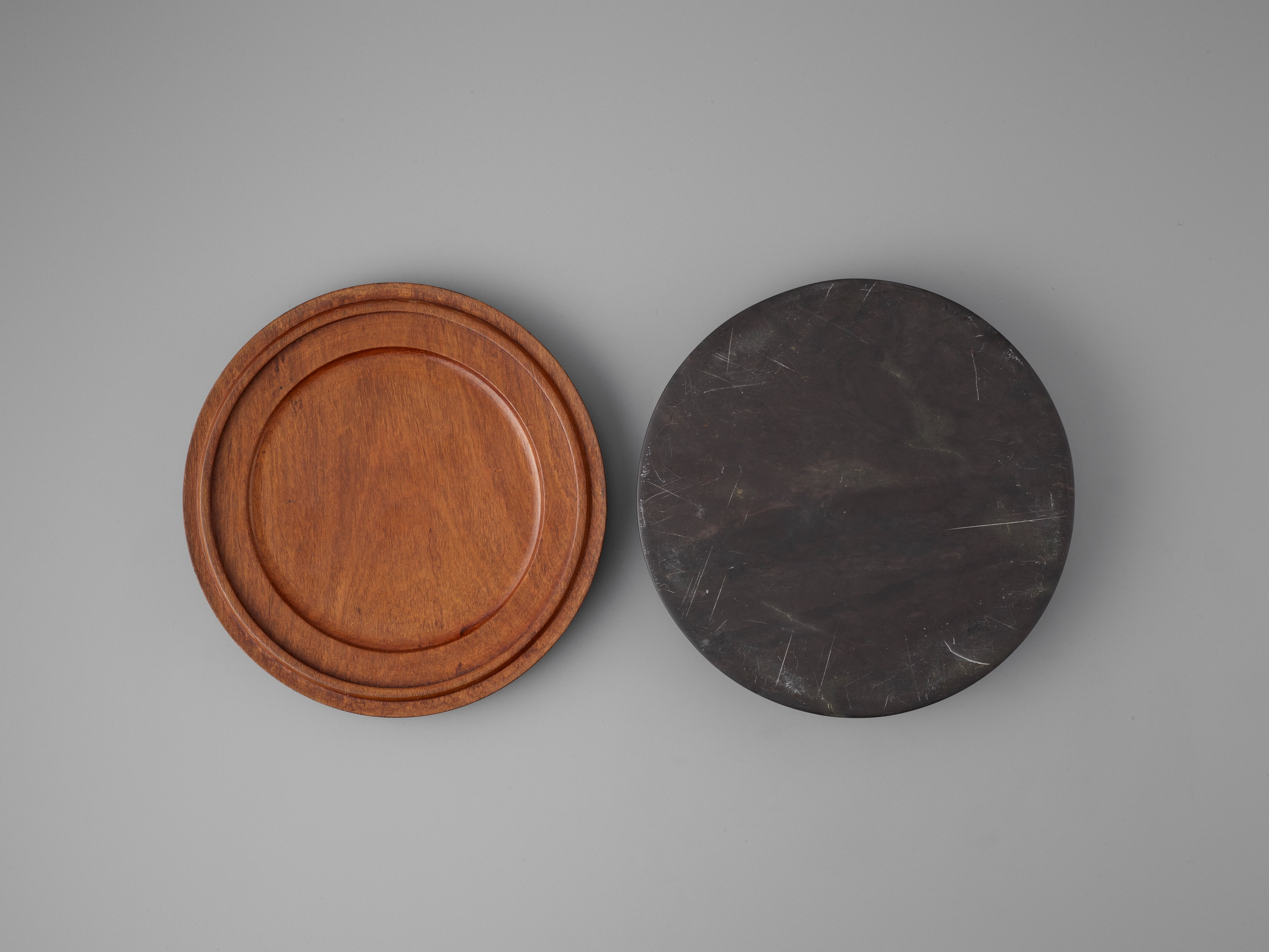 A DUAN INKSTONE WITH A JADEITE-INSET HUANGHUALI COVER, QING - Image 6 of 7
