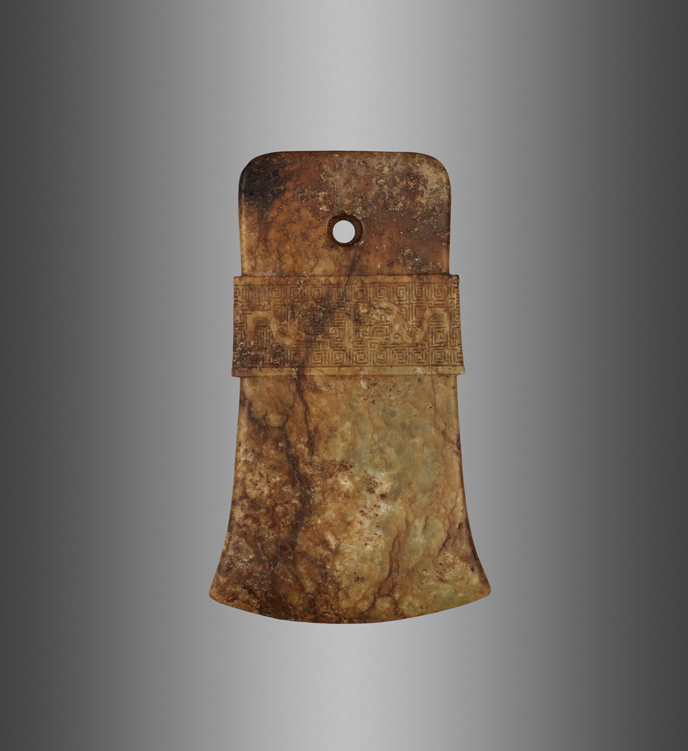 AN ARCHAISTIC RUSSET AND CELADON JADE AXE, QI, MING DYNASTY