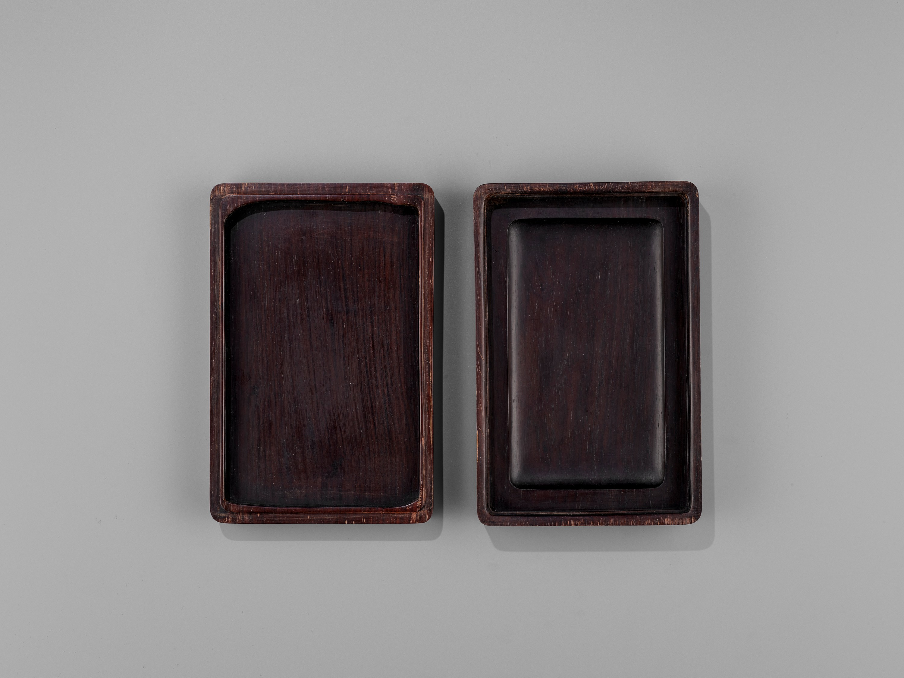 AN INSCRIBED DUAN INKSTONE AND FITTED HUANGHUALI BOX, QING - Image 10 of 11