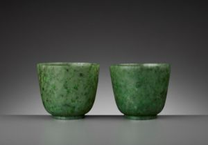 A PAIR OF SPINACH-GREEN JADE CUPS, QING DYNASTY