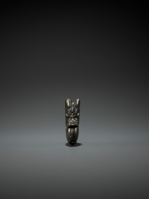 A DARK-GREEN JADE 'PIG-DRAGON' CARVING, ZHULONG, HONGSHAN CULTURE, C. 4000-3000 BC - Image 5 of 6