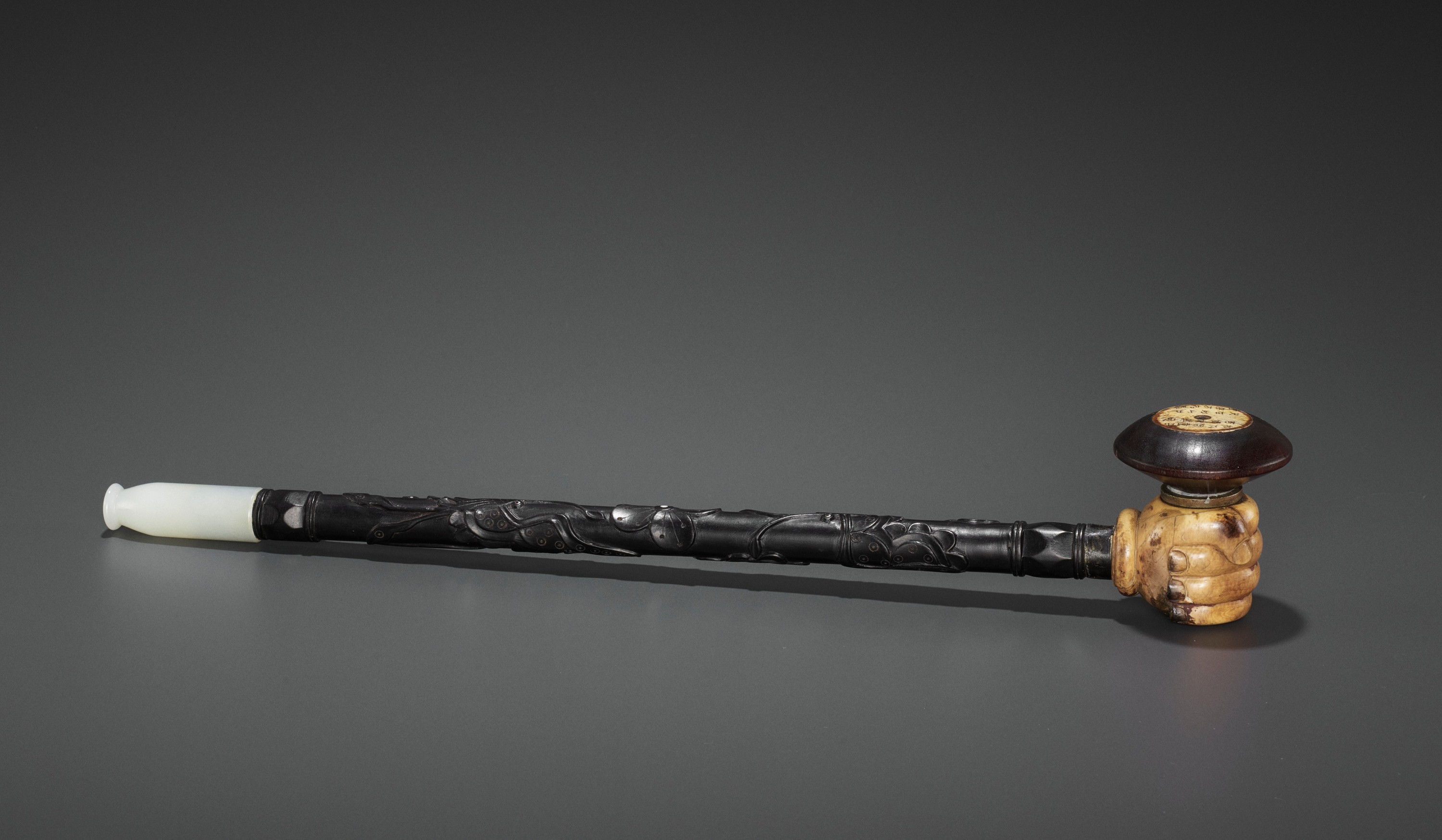 A HARDWOOD OPIUM PIPE WITH JADEITE, IVORY AND ZITAN FITTINGS, LATE QING TO REPUBLIC
