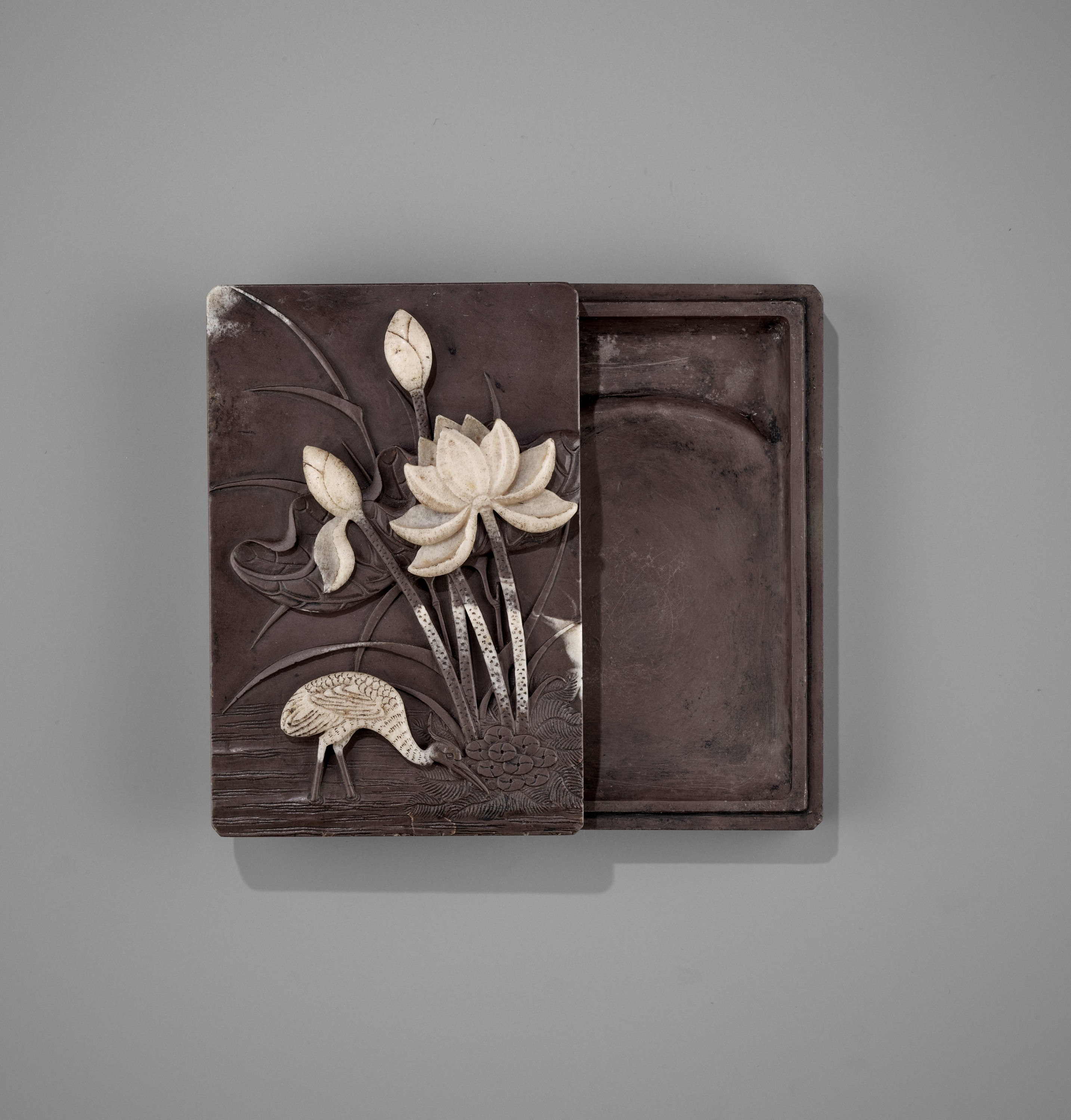 A DUAN 'CRANE AND LOTUS' INKSTONE AND COVER, QING