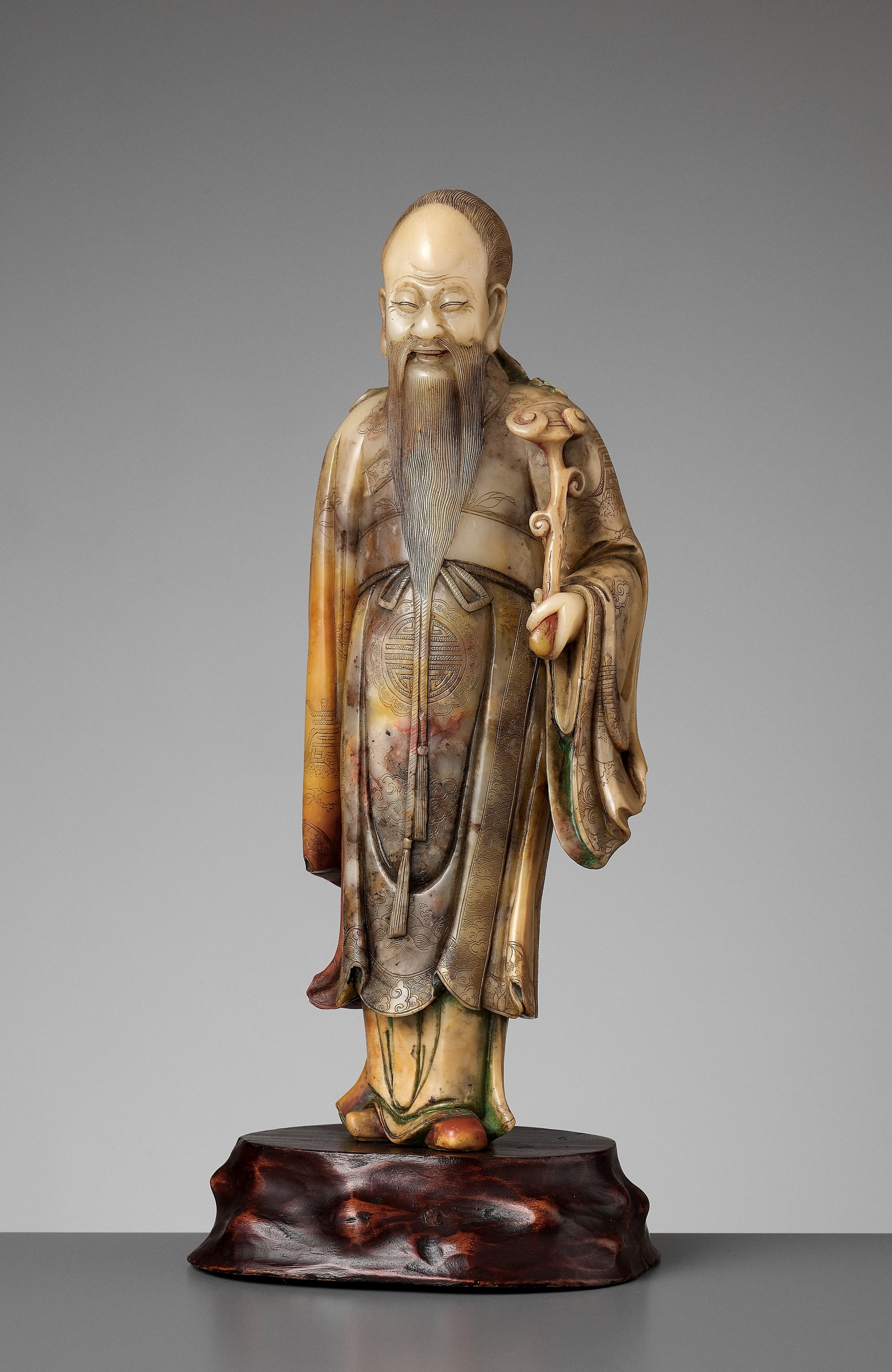A CARVED SOAPSTONE FIGURE OF SHOULAO, MID-QING