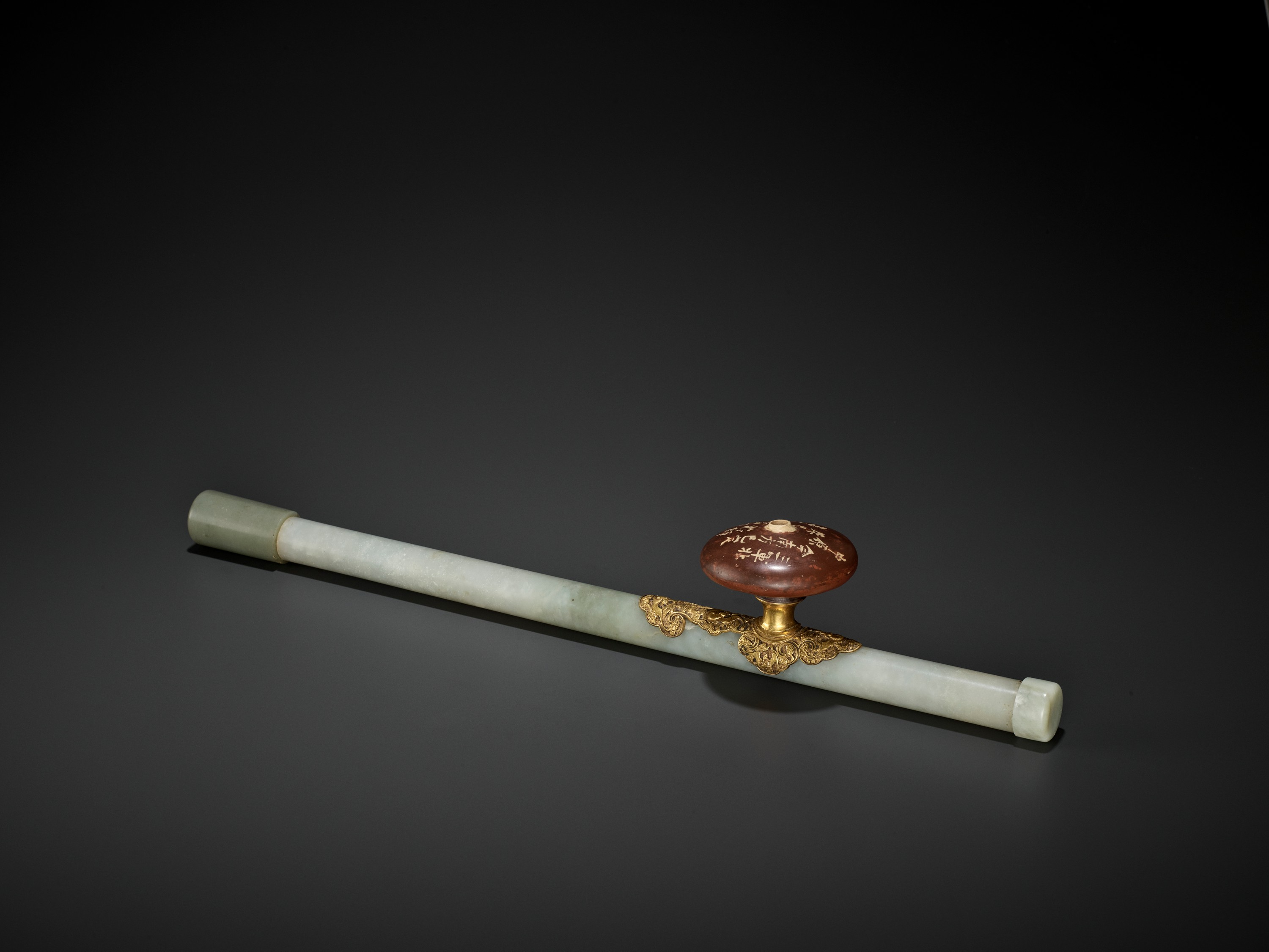A JADE AND GILT-BRONZE 'WUFU' OPIUM PIPE, QING DYNASTY