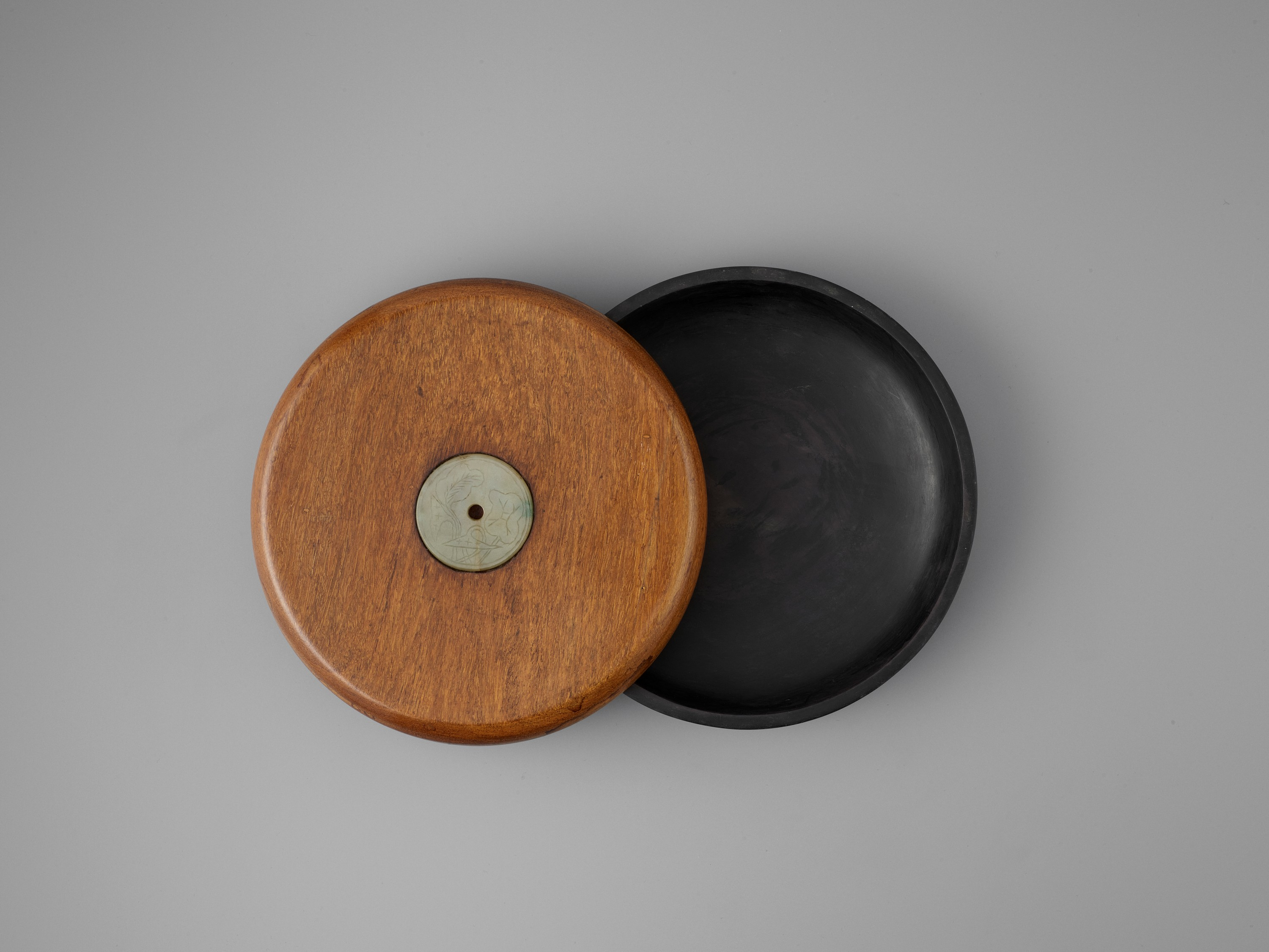 A DUAN INKSTONE WITH A JADEITE-INSET HUANGHUALI COVER, QING - Image 3 of 7