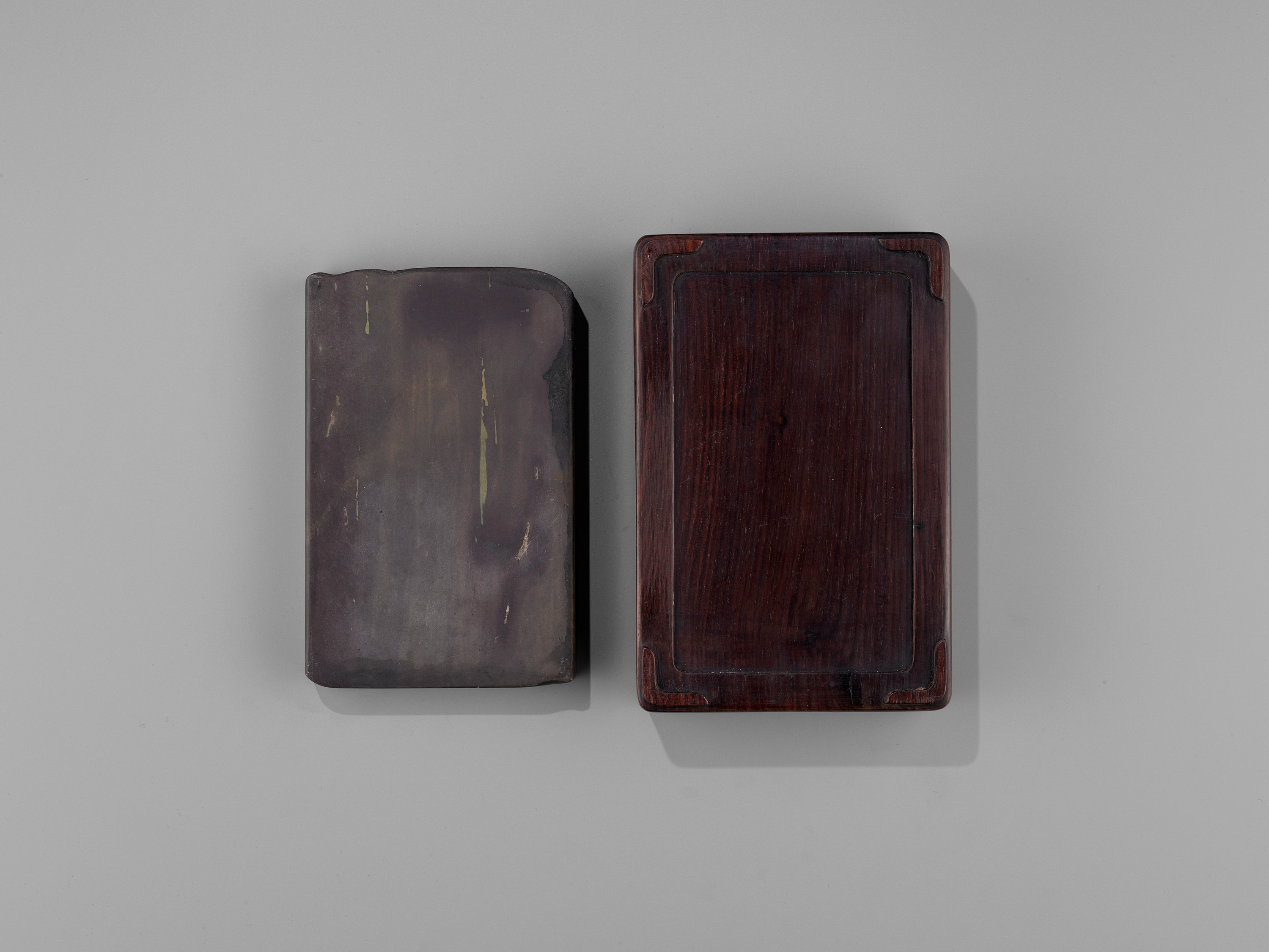 AN INSCRIBED DUAN INKSTONE AND FITTED HUANGHUALI BOX, QING - Image 9 of 11