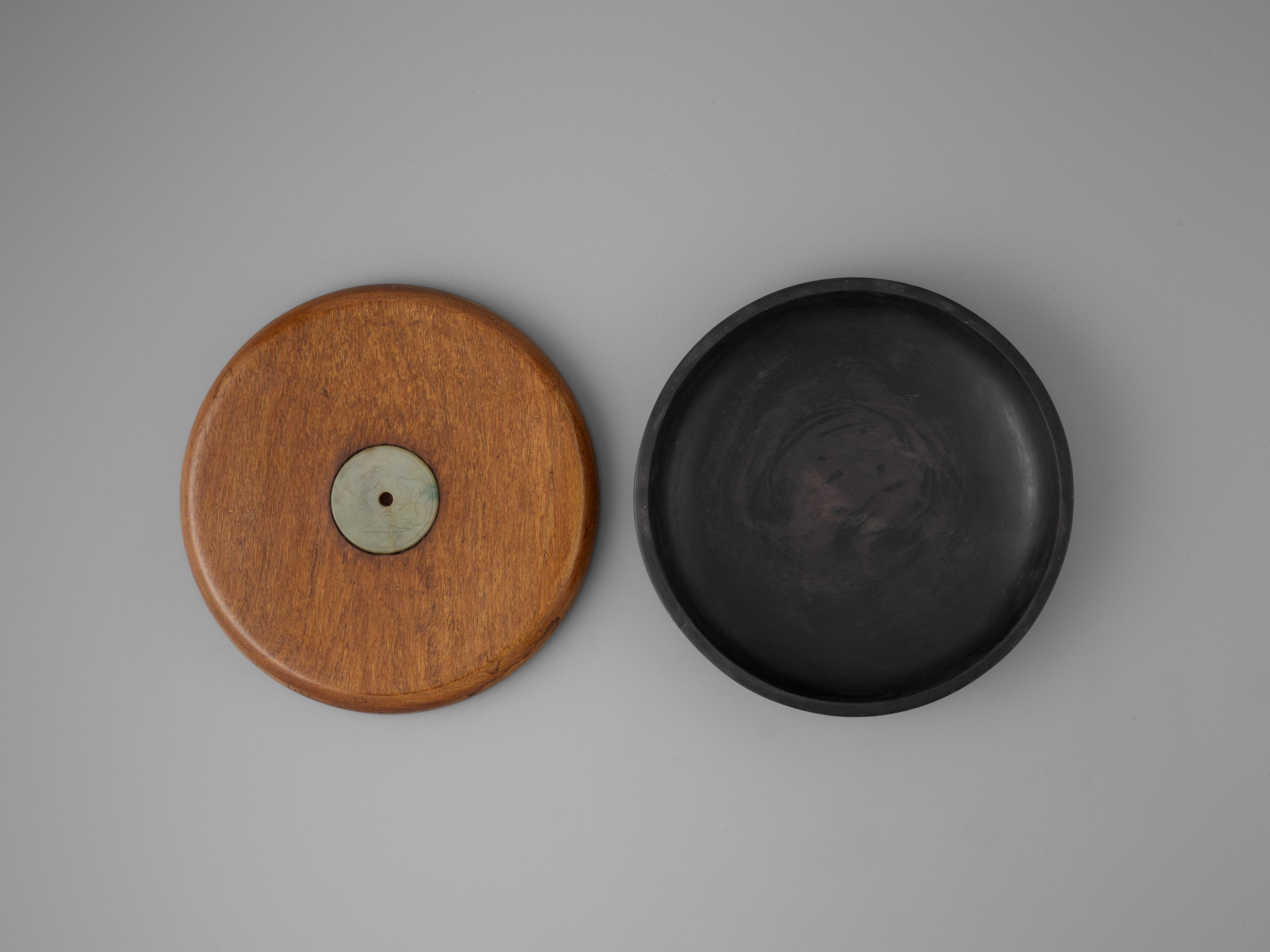 A DUAN INKSTONE WITH A JADEITE-INSET HUANGHUALI COVER, QING - Image 4 of 7
