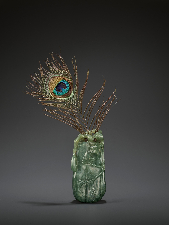 A DARK GREEN JADEITE 'MELON' SOLIFLORE VASE, QING
