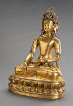 A LARGE GILT BRONZE FIGURE OF CROWNED BUDDHA SHAKYAMUNI
