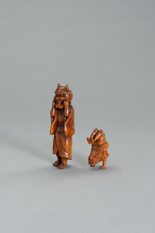 TWO WOOD NETSUKE OF A SHISHIMAI DANCER