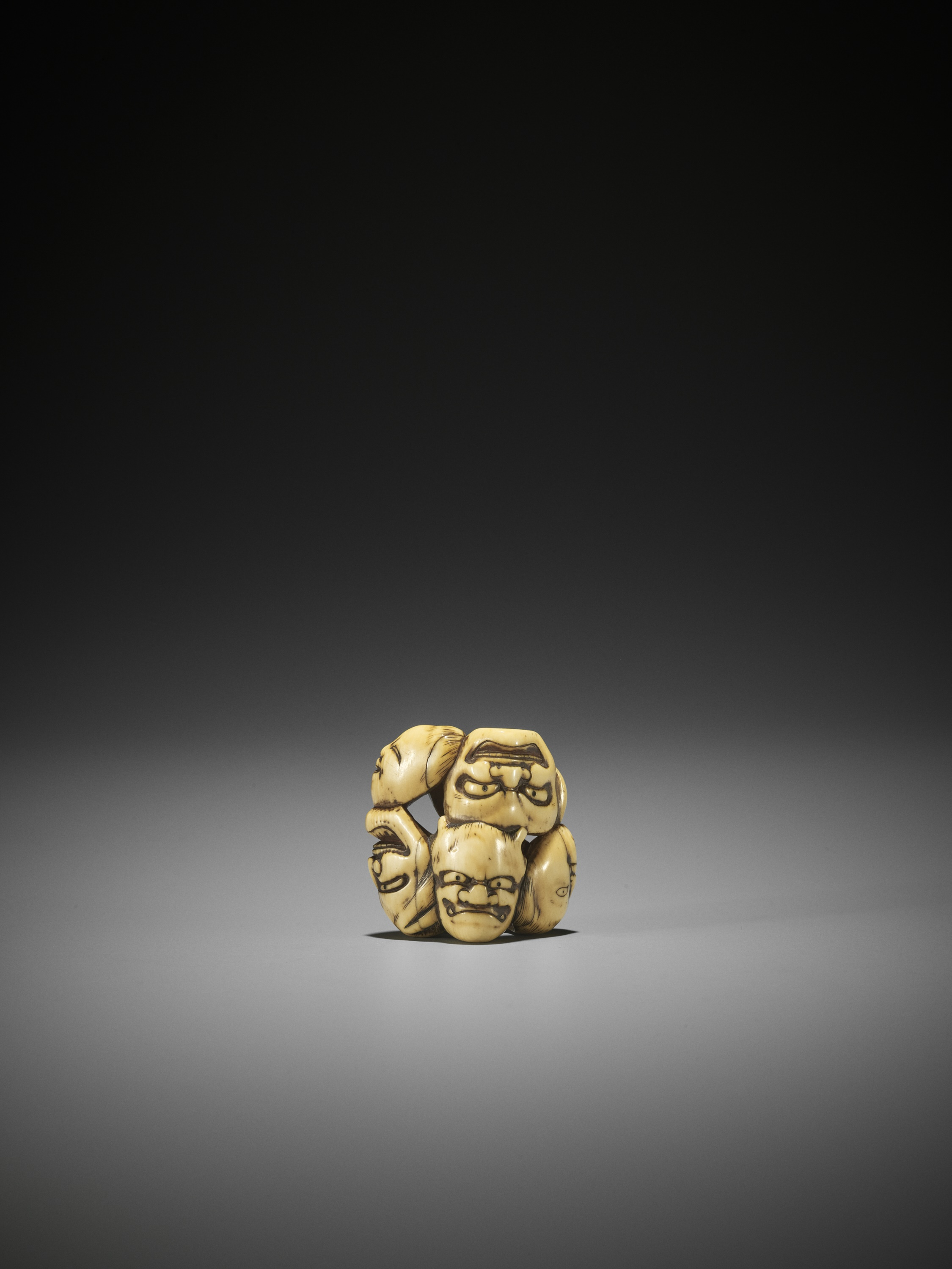 AN IVORY NETSUKE OF A GROUP OF SEVEN MASKS - Image 2 of 8