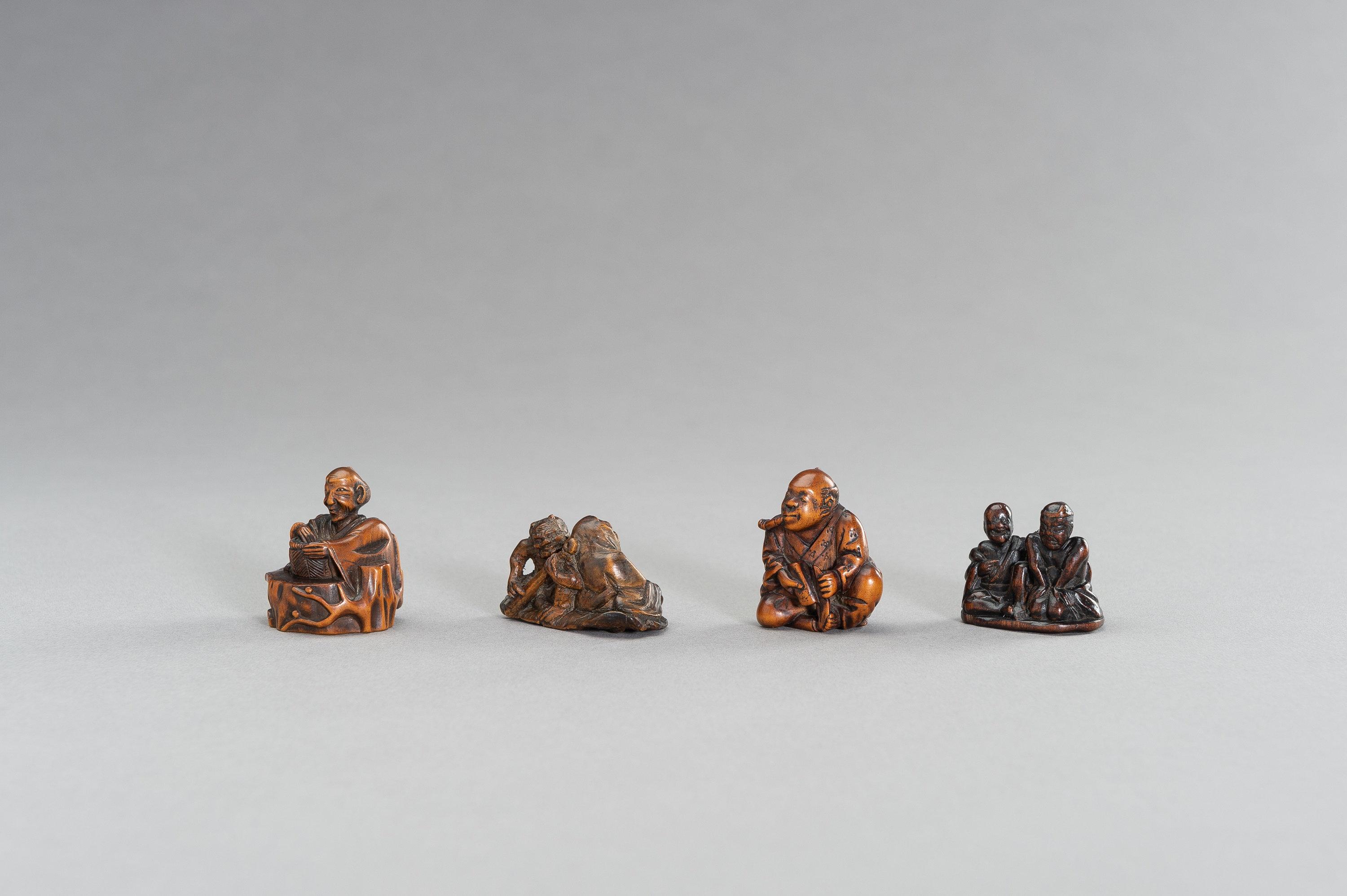 A GROUP OF FOUR FIGURAL WOOD NETSUKE - Image 2 of 3