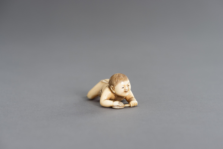 MASATSUGU: A FINE IVORY NETSUKE OF A CRAWLING INFANT - Image 3 of 3