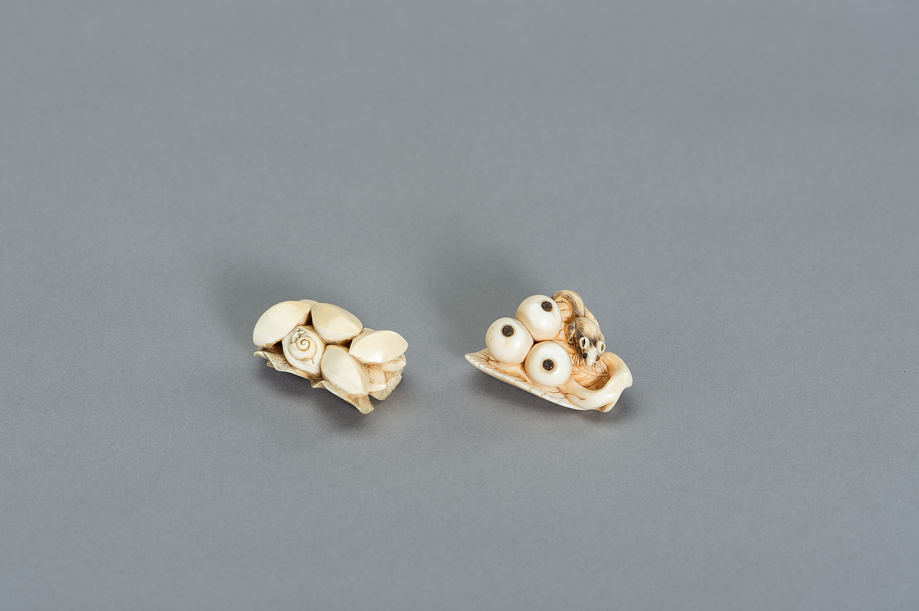 TWO STILL LIFE IVORY NETSUKE WITH SMALL CREATURES