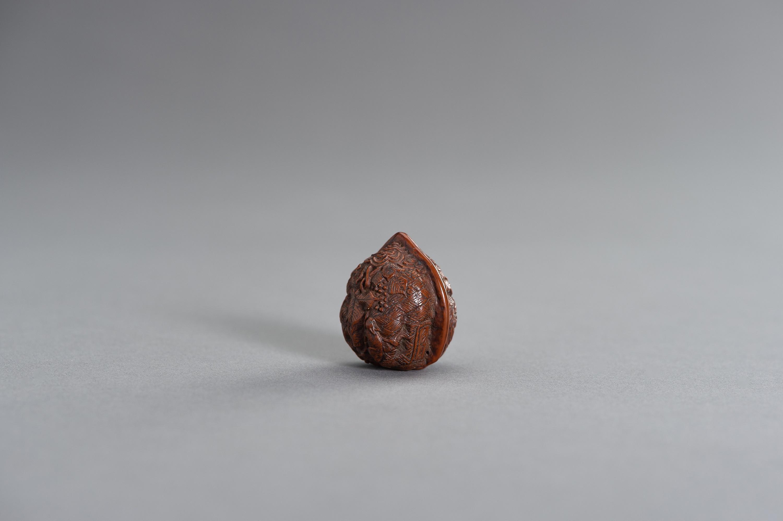 A KURUMI (WALNUT) NETSUKE OF GRAPEVINE AND SMALL ANIMALS - Image 2 of 3