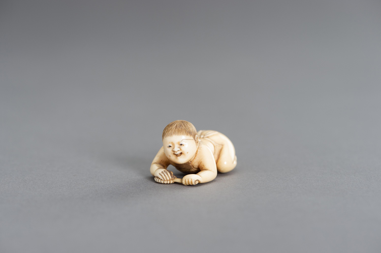 MASATSUGU: A FINE IVORY NETSUKE OF A CRAWLING INFANT - Image 2 of 3