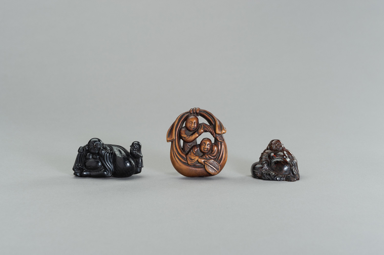 A GROUP OF THREE NETSUKE OF HOTEI AND KARAKO