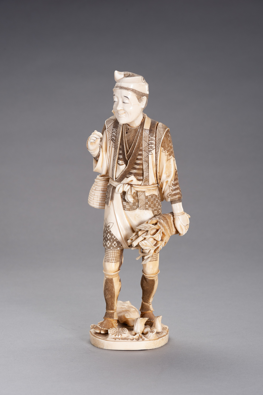AN IVORY AND BONE OKIMONO OF A WOOD GATHERER - Image 2 of 2