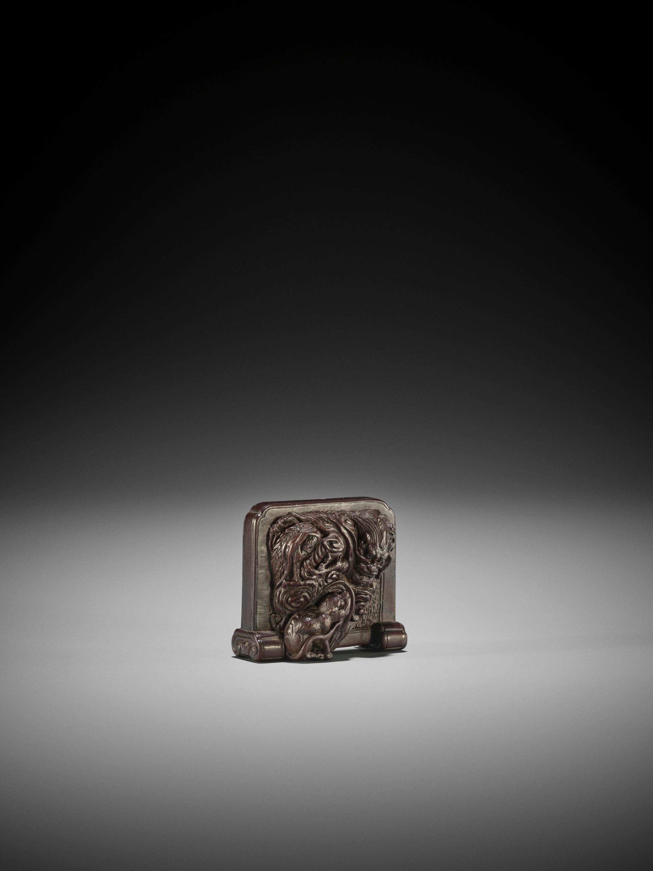 TAMETAKA: A WOOD NETSUKE OF A TSUITATE WITH TIGER AND DRAGON - Image 2 of 3