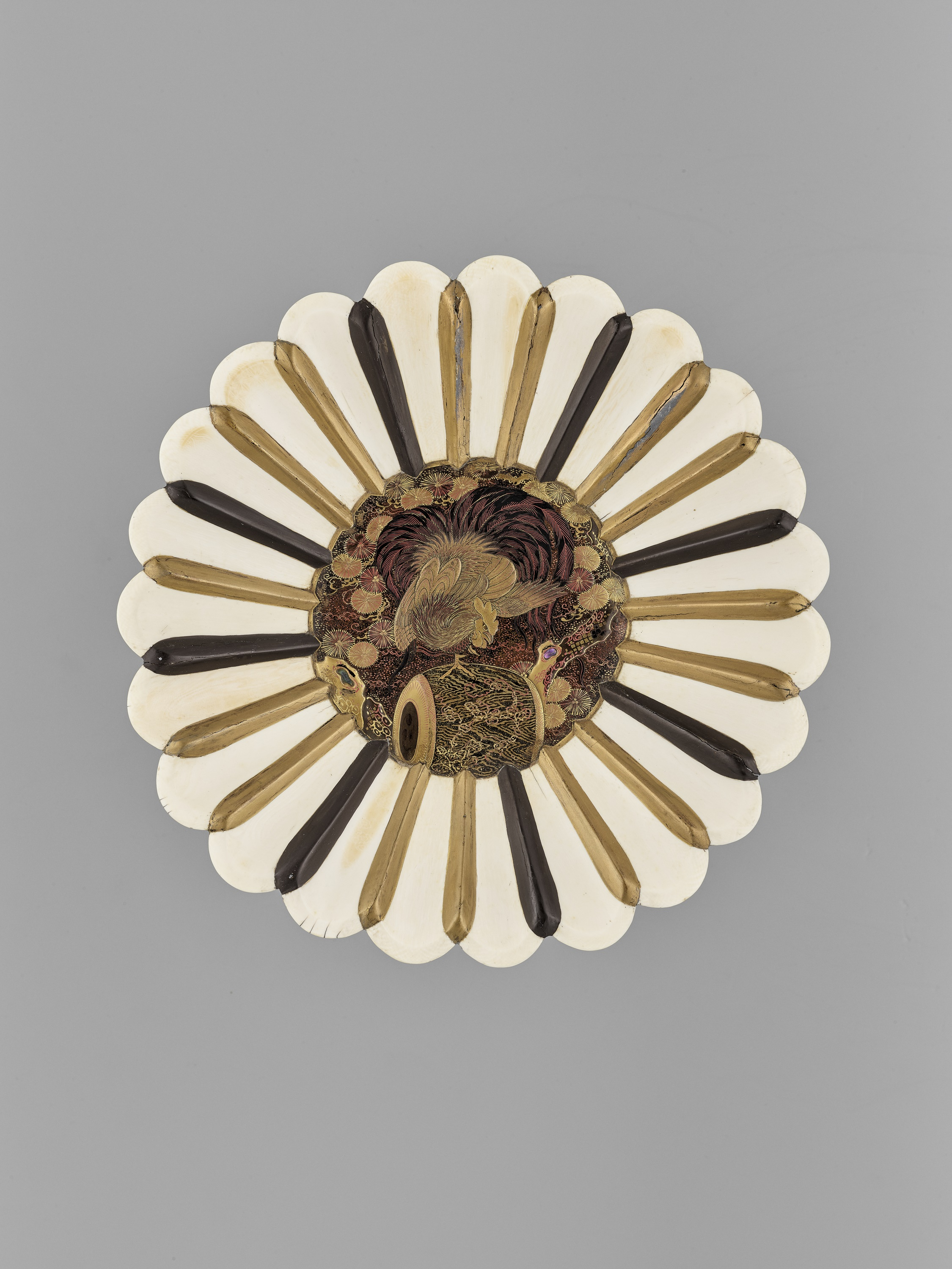 A LACQUERED WOOD AND IVORY FOOTED DISH PLATE