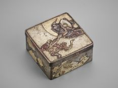 A SMALL SILVERED SENTOKU 'SHOKI AND ONI' BOX AND COVER