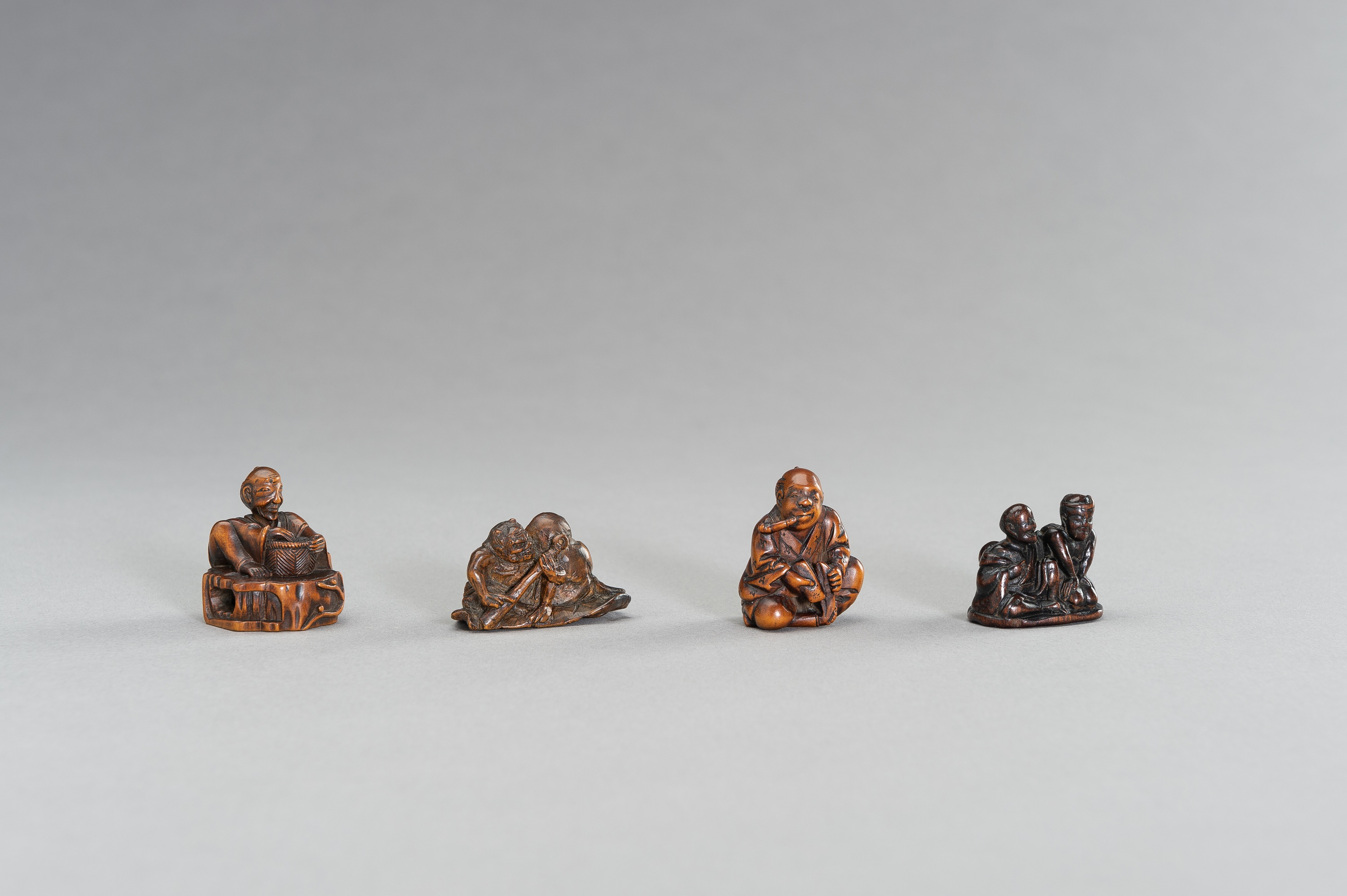 A GROUP OF FOUR FIGURAL WOOD NETSUKE - Image 3 of 3