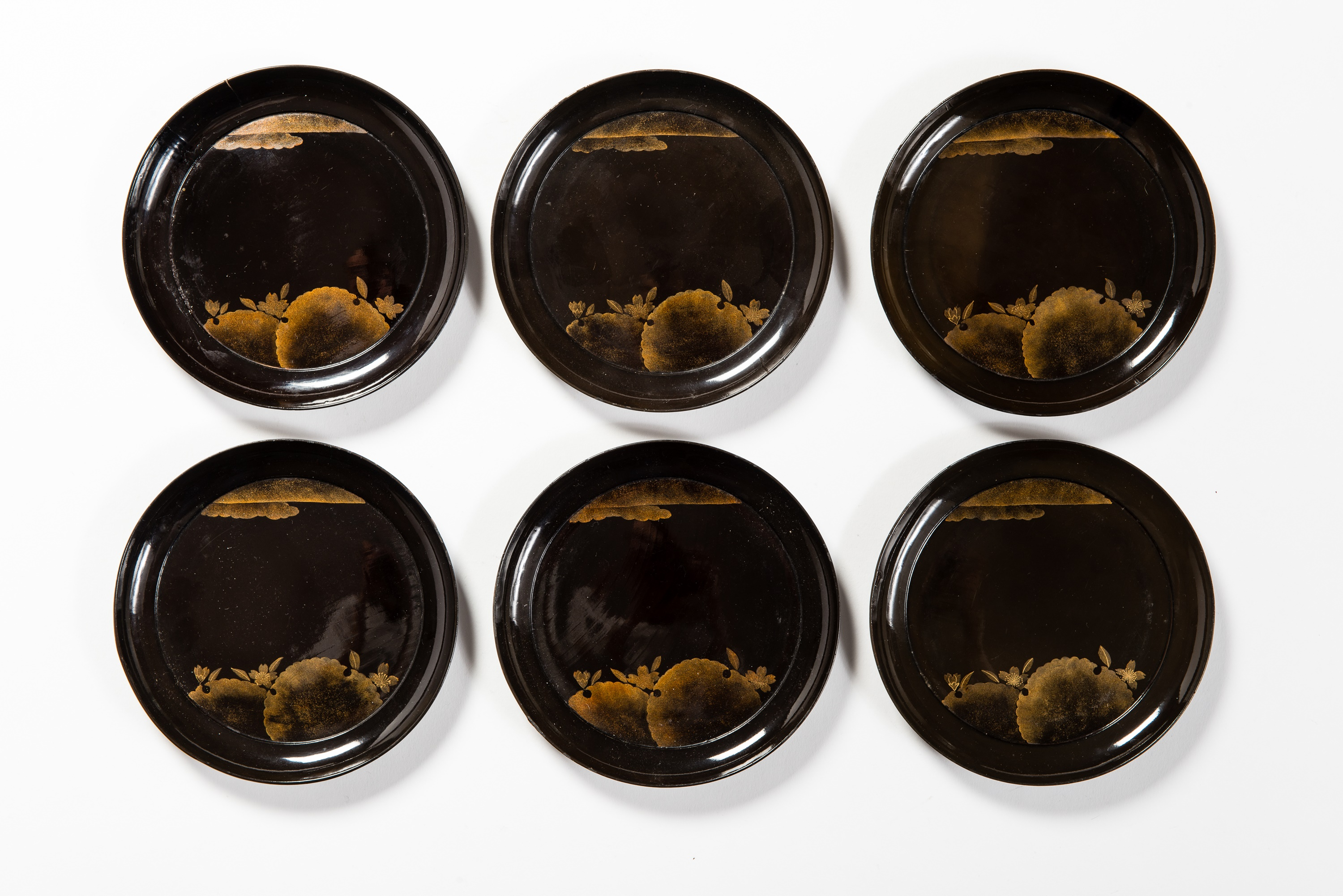 SET OF SIX LACQUERED PLATES