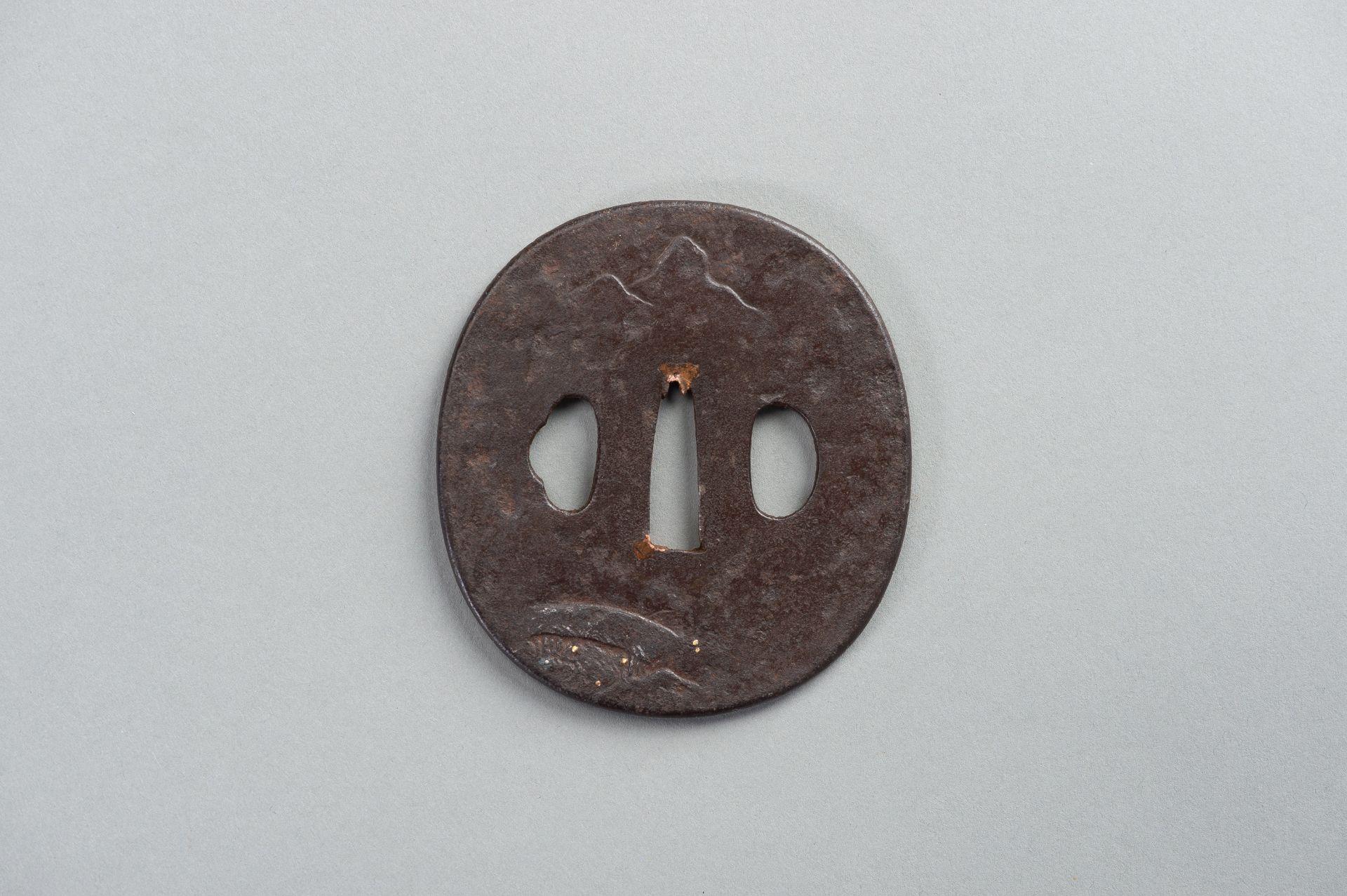 AN IRON TSUBA WITH A LITERATI