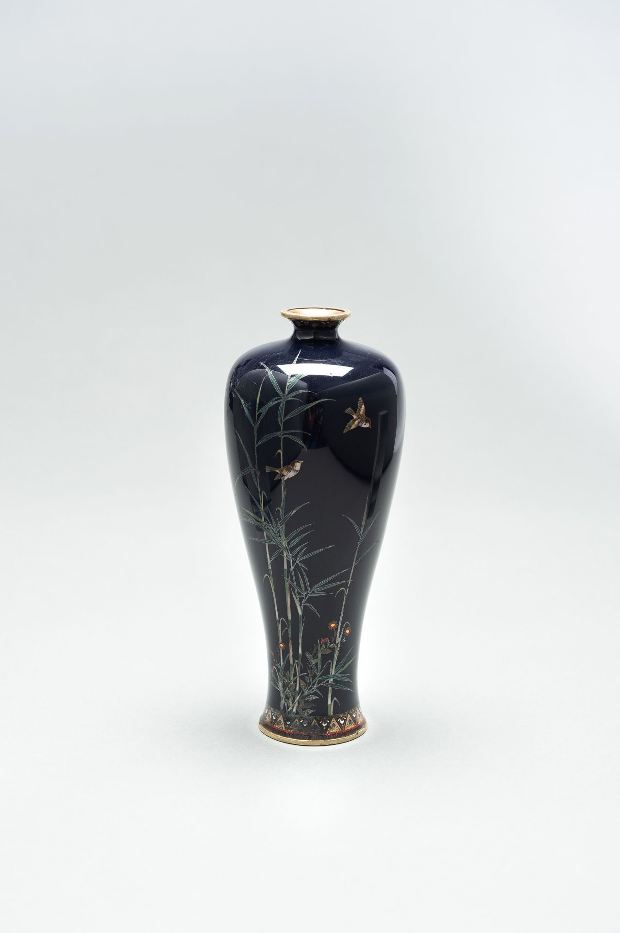 A CLOISONNE ENAMEL VASE WITH BAMBOO AND BIRDS