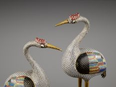 A PAIR OF GILT BRONZE AND CLOISONNE ENAMEL FIGURES OF CRANES, QING DYNASTY