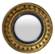 Round convex mirror with gilded frame in gold leaf, mid-nineteenth century. Diameter 50 cm, depth 10