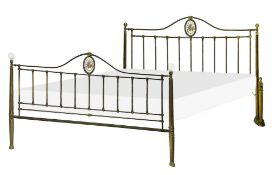 Elegant brass bed frame from the nineteenth century, with porcelain medallion on headboard and footb